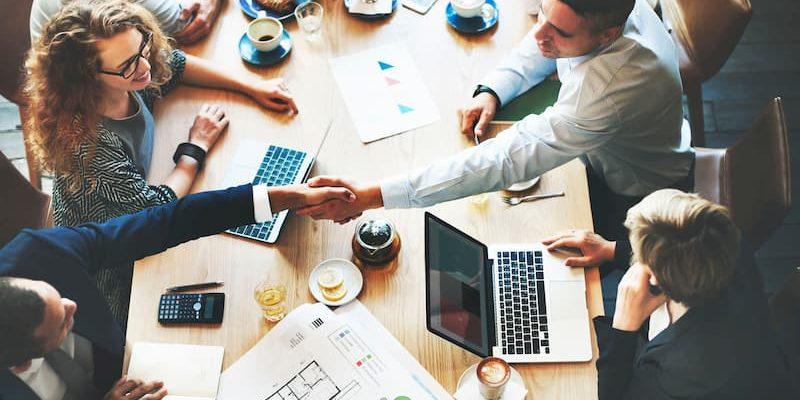 Boardroom-meeting-with-a-handshake-800.jpg